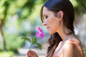 woman smelling flower - no fear of exposure