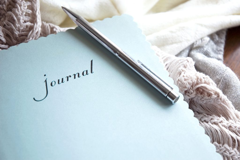 journal writing with pen